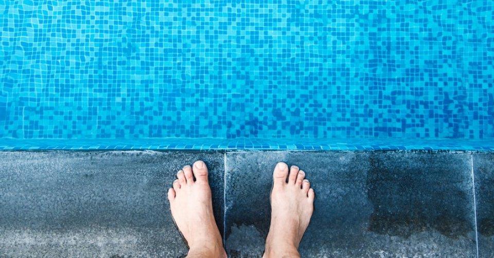 feet on edge of pool